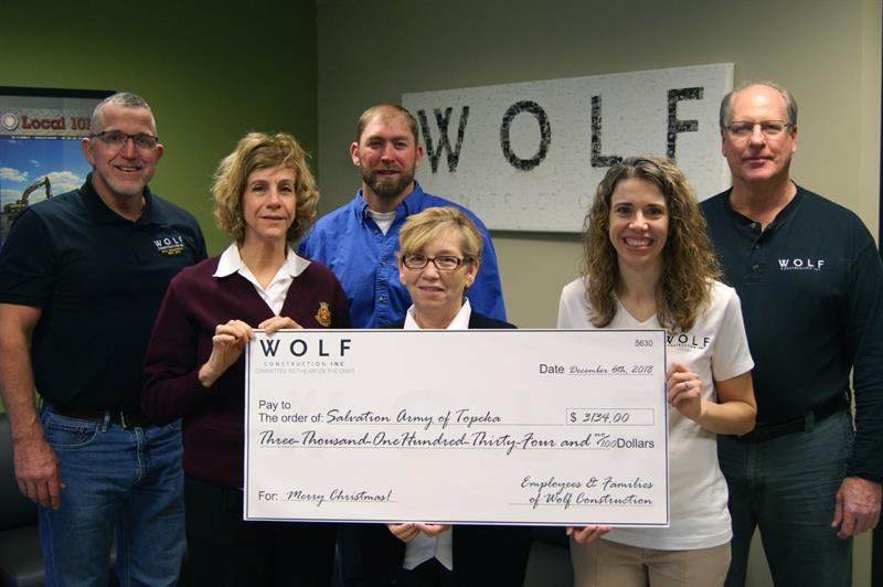 Wolf presents check to Topeka Salvation Army.